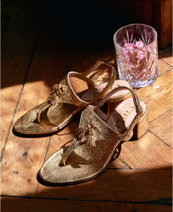 Gold sandals in goat leather with T-bar strap and small pompons SAMMY GOLD